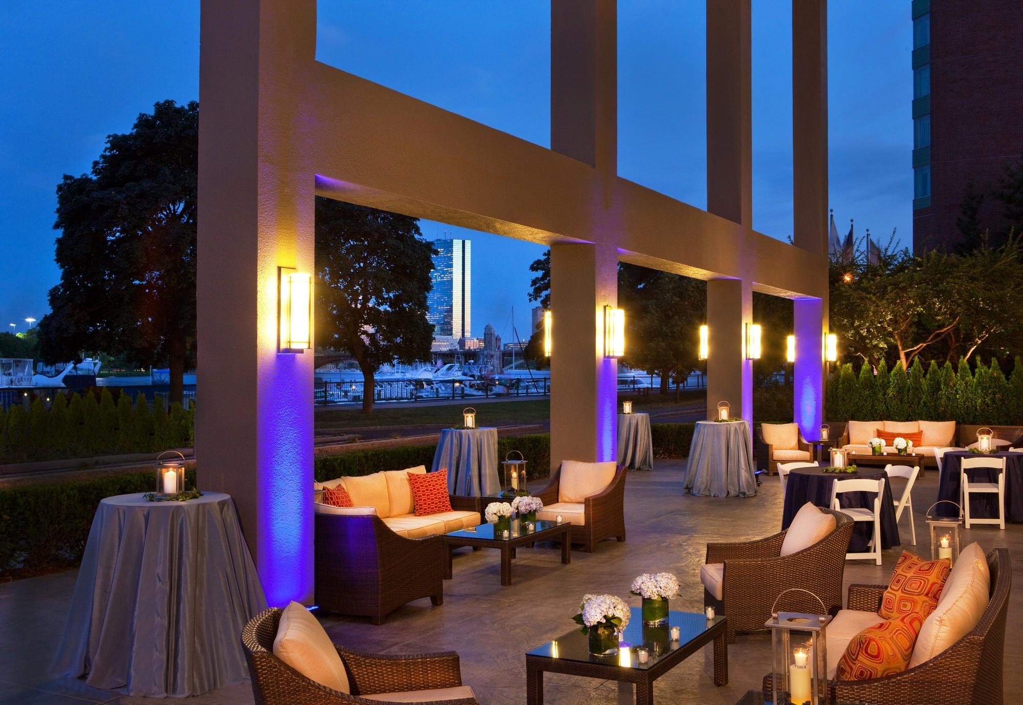Royal Sonesta Boston Riverside Terrace Tables Evening